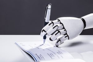 Photo Of Robot Hand Signing Cheque With Pen
